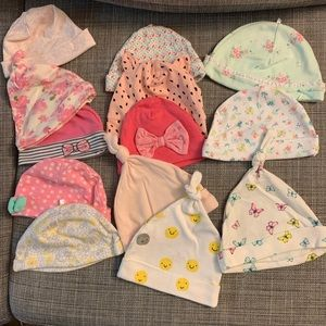 13 Assorted baby beanies. Size 0 to 9 mths.